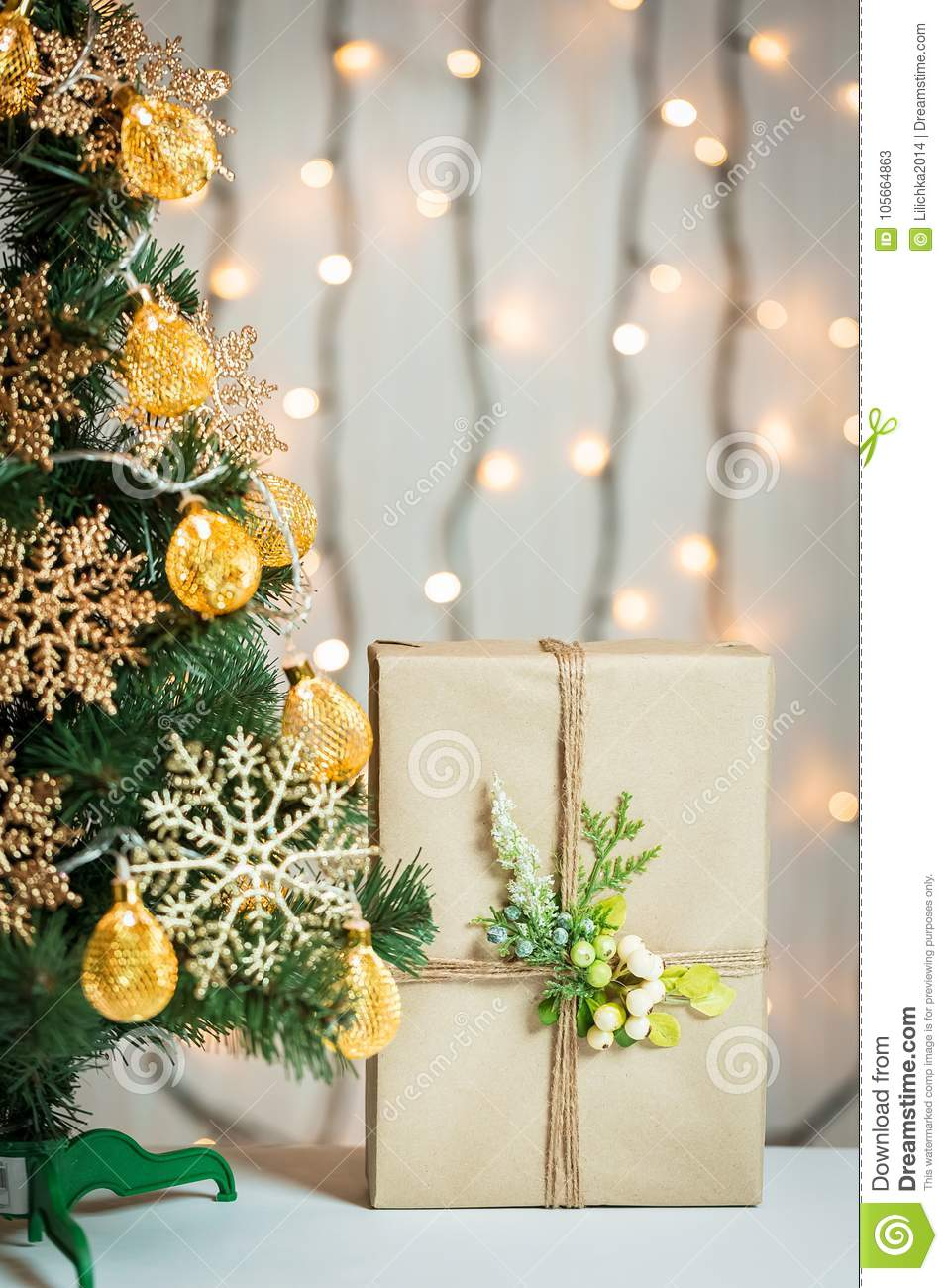A Christmas Tree Decorated With Snowflakes And A Garland On The ...