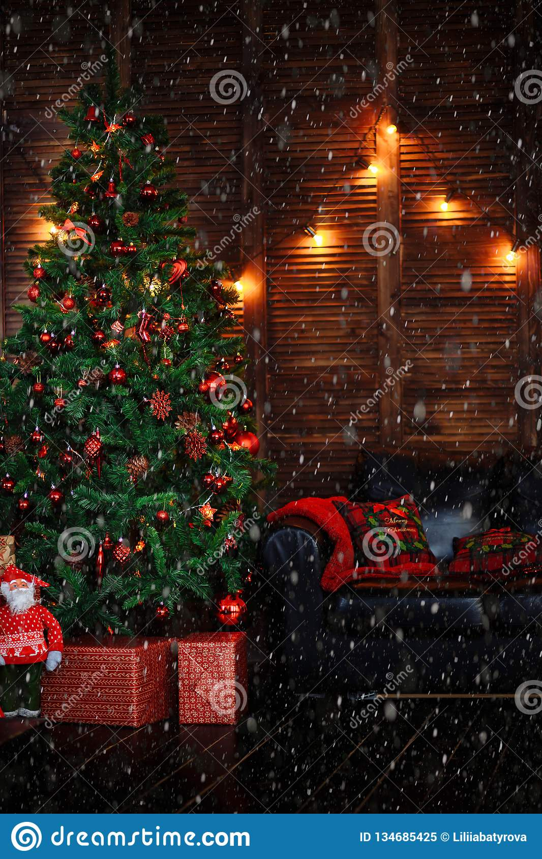 A Christmas Tree Decorated With Toys Ornaments Beads Red Garland