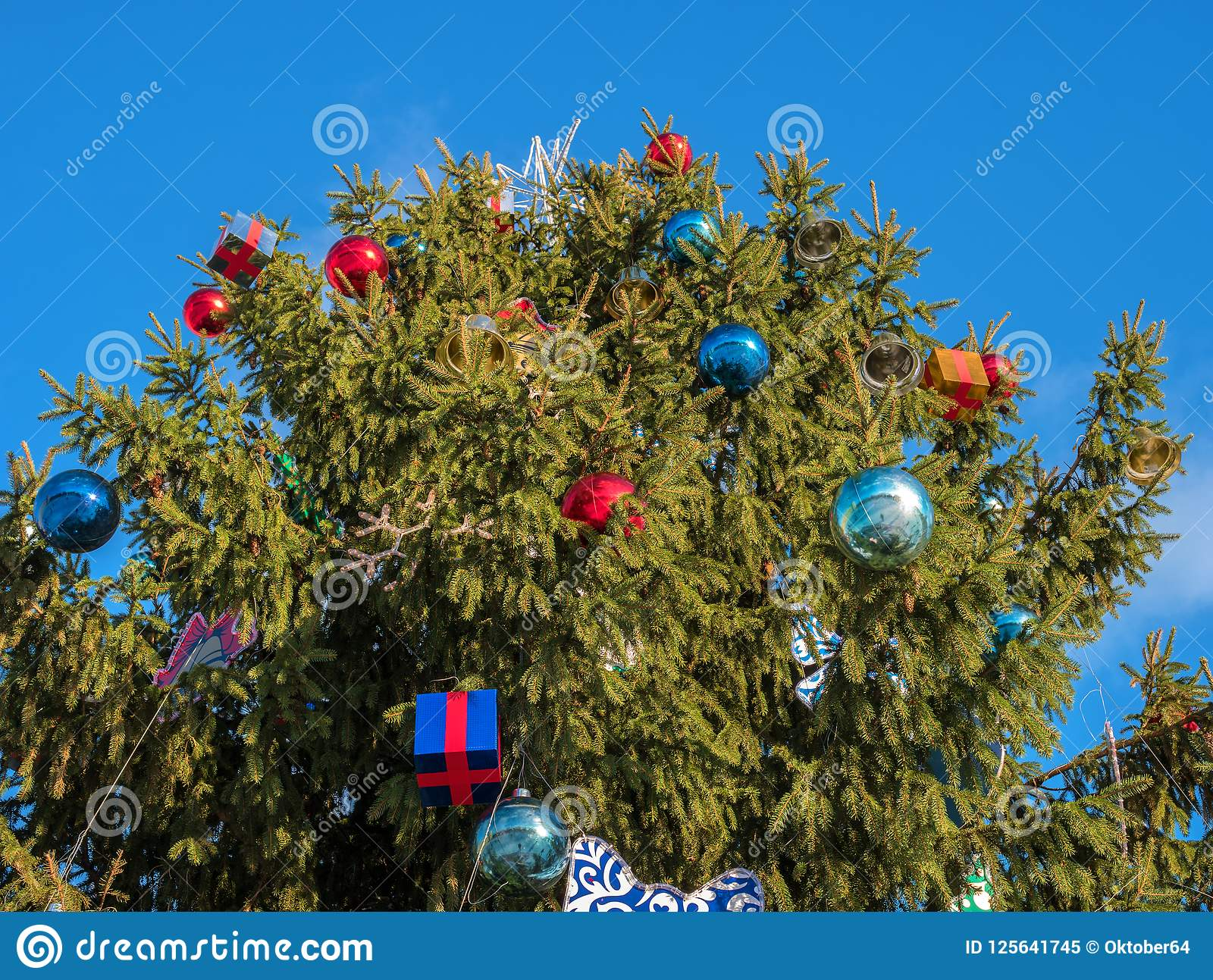 download christmas tree decorated with toys tree stands on the street top christmas tree