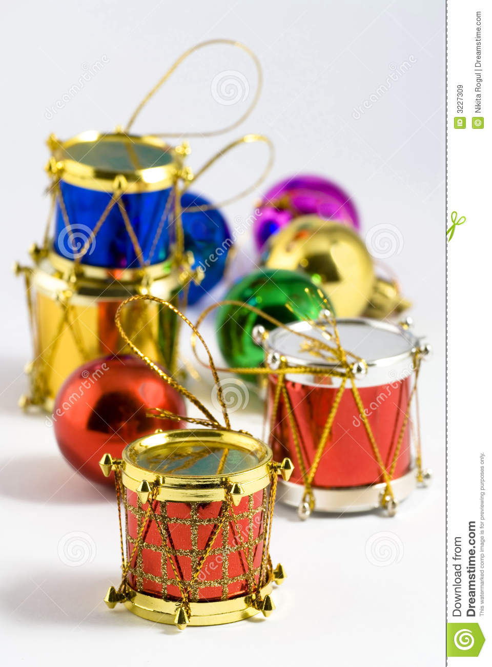 Several colorful christmas tree decorations of different types.