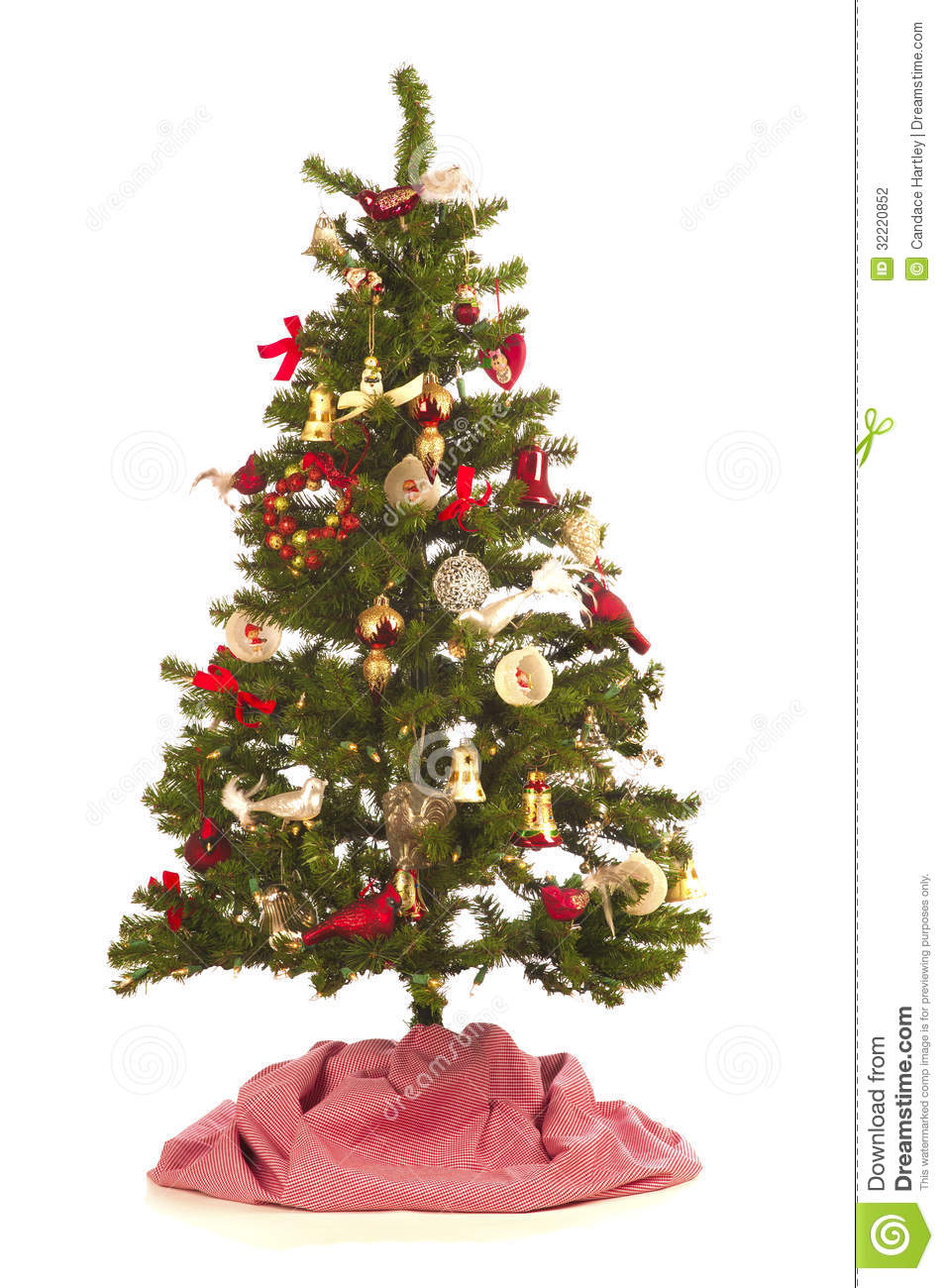Delightful Christmas Tree With Festive Decorations, Antique And New, On White  Background With A Red And White Tree Skirt