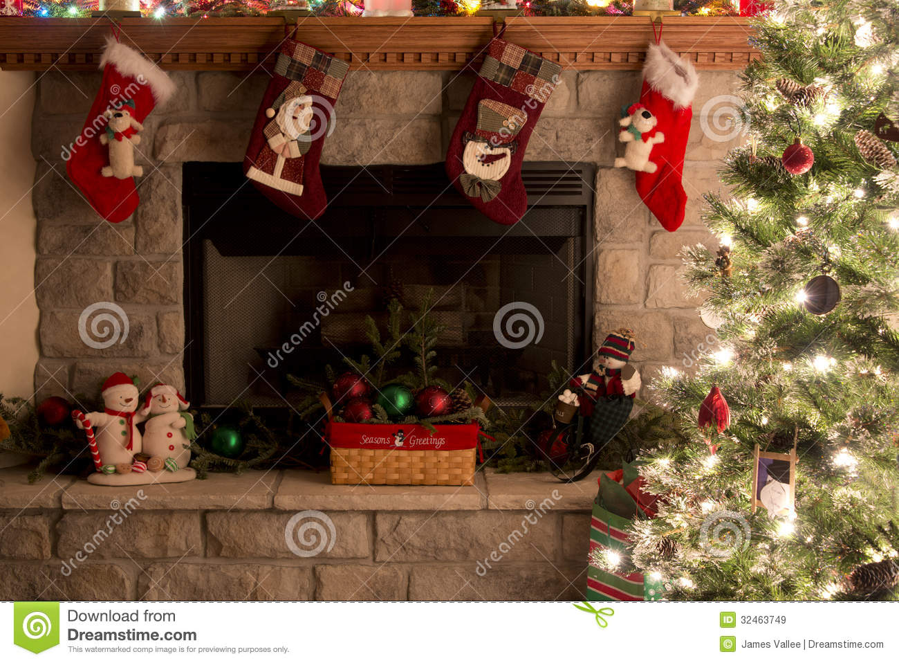 christmas tree and fireplace with christmas stockings royalty free