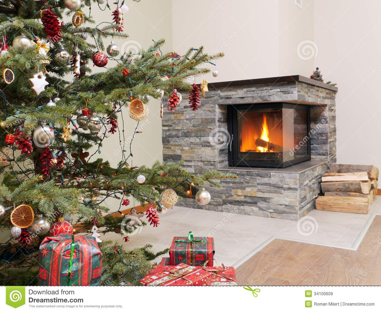 Christmas Tree By The Fireplace Stock Image - Image: 34100609
