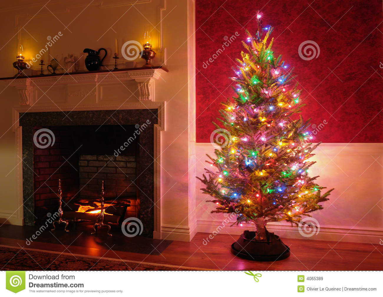 christmas tree and fireplace in traditional house royalty free