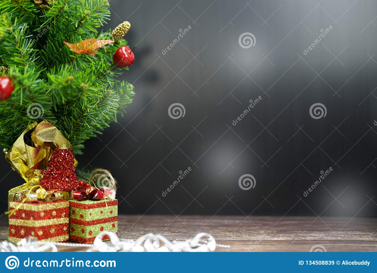 Christmas Tree with Gifts, on black background