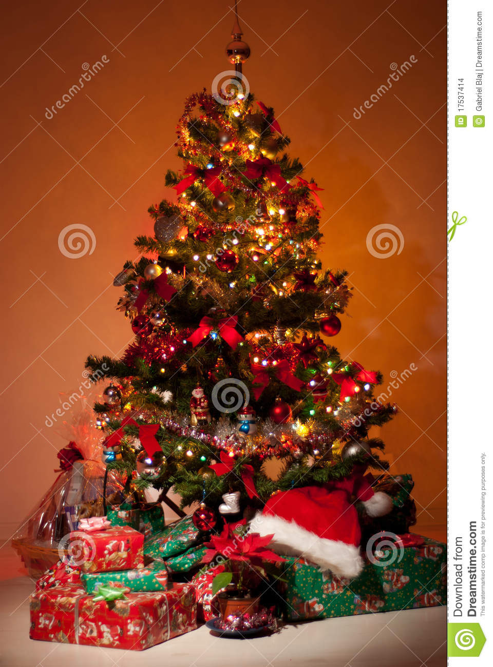 christmas tree with gifts and lights stock photo image. Black Bedroom Furniture Sets. Home Design Ideas