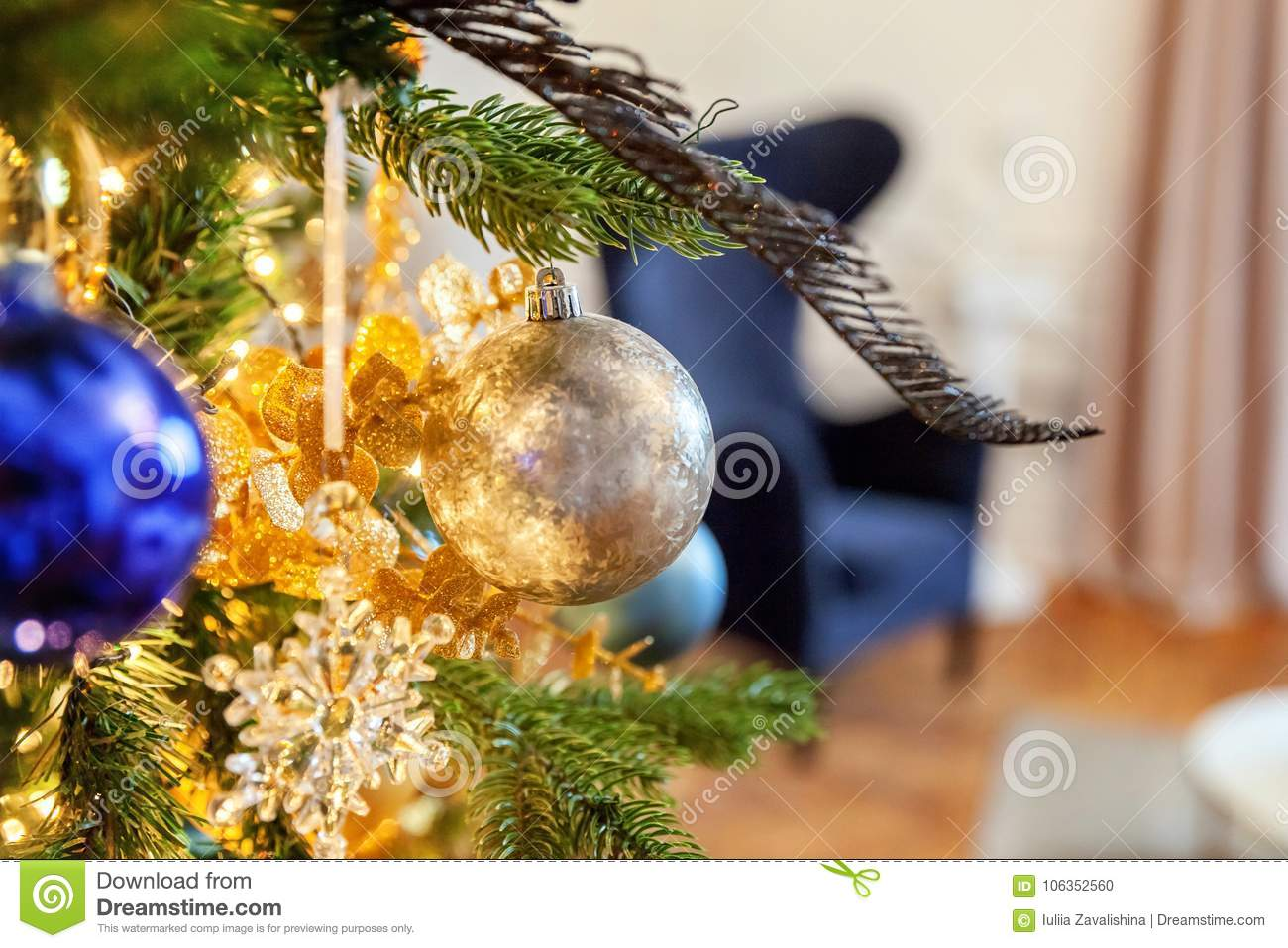 christmas tree with gold and blue decorations