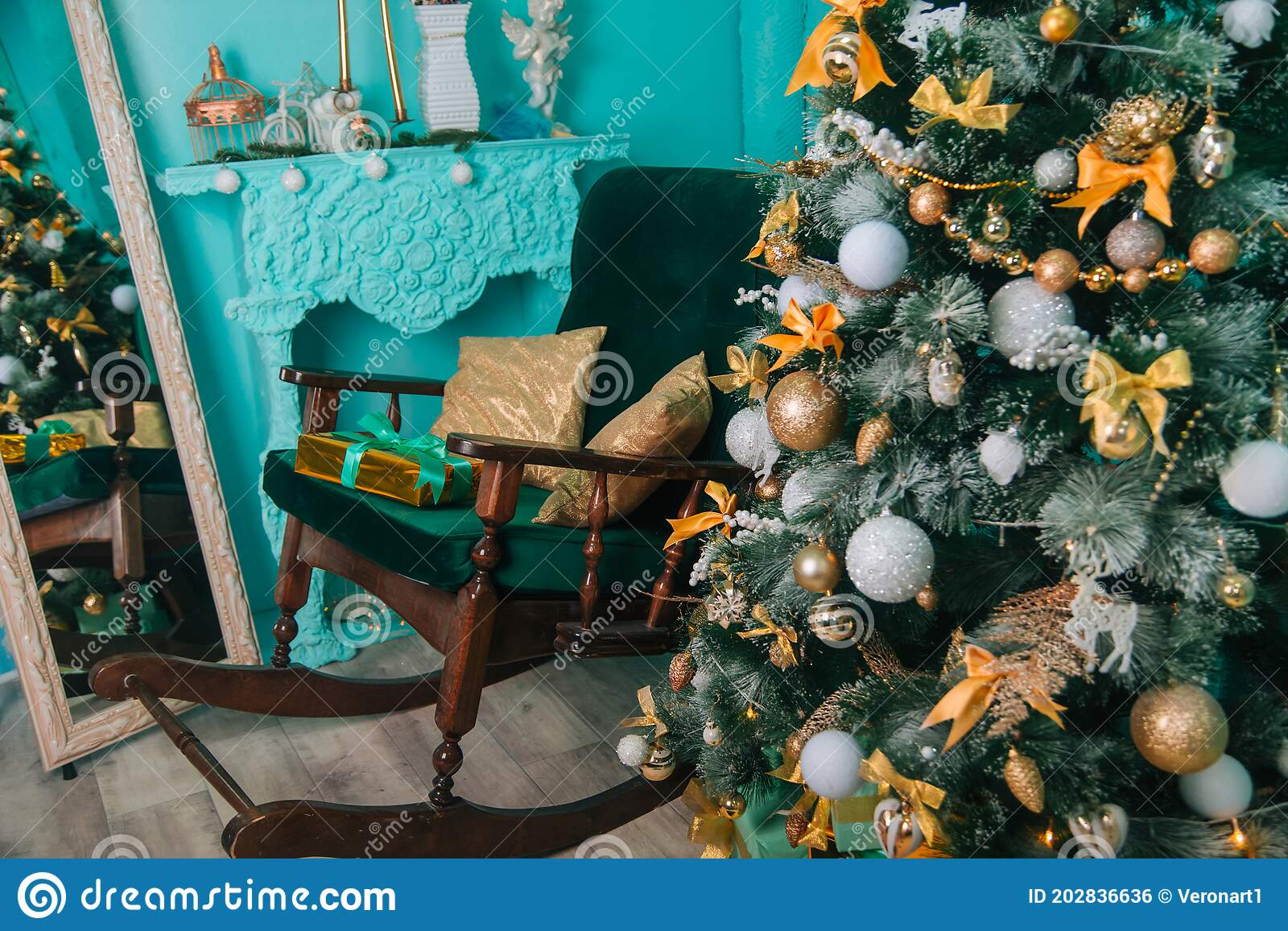 Christmas Tree With Gold And White Balls In A Turquoise Interior Christmas With Gifts Festive Decoration New Years Stock Photo Image Of Pine Door 202836636
