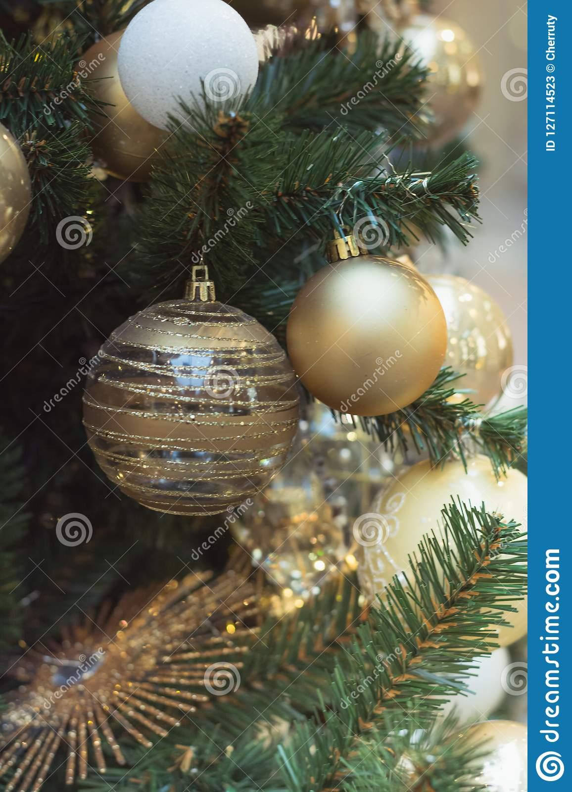 Christmas tree with holiday silver balls and lights with copy space on blurred bokeh in interiors. Close up.
