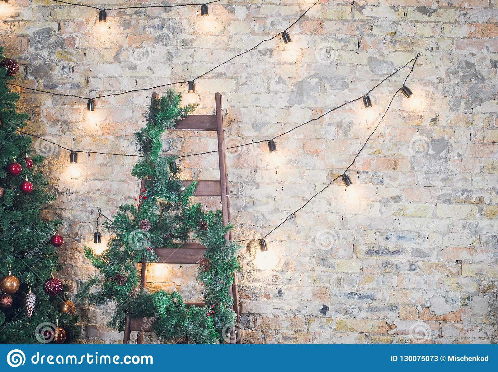 Christmas Tree With Garlands On A Brick Wall Background Stock Image Image Of Copy Ornament 130075073