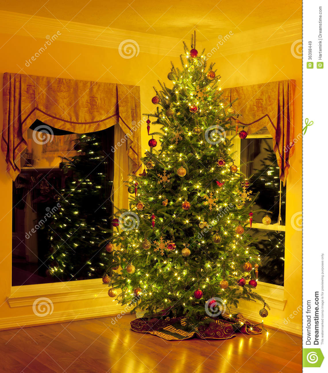 Christmas Tree In Living Room Corner With Reflections Stock Image