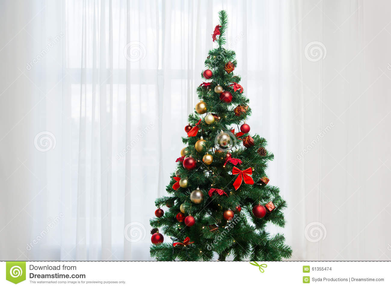 Christmas Tree In Living Room christmas tree in living room over window curtain stock photo