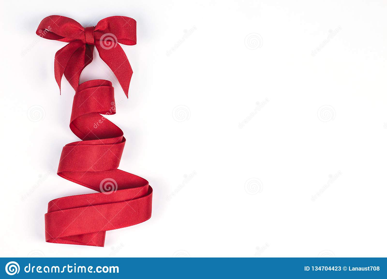 Christmas Tree Made Of Red Ribbon On Isolated White