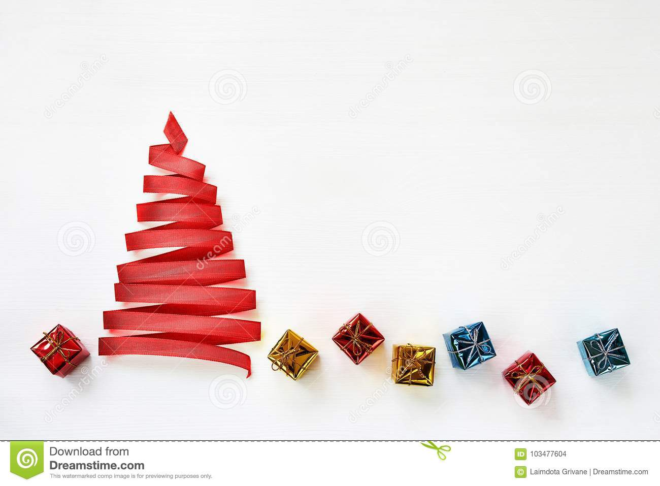 Christmas Tree Made From Red Ribbon With Small Gifts On