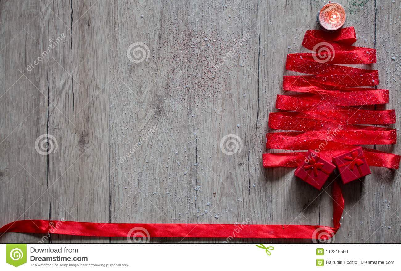 christmas tree made from ribbon on a wooden background with gi - How To Decorate A Christmas Tree With Ribbon Horizontally