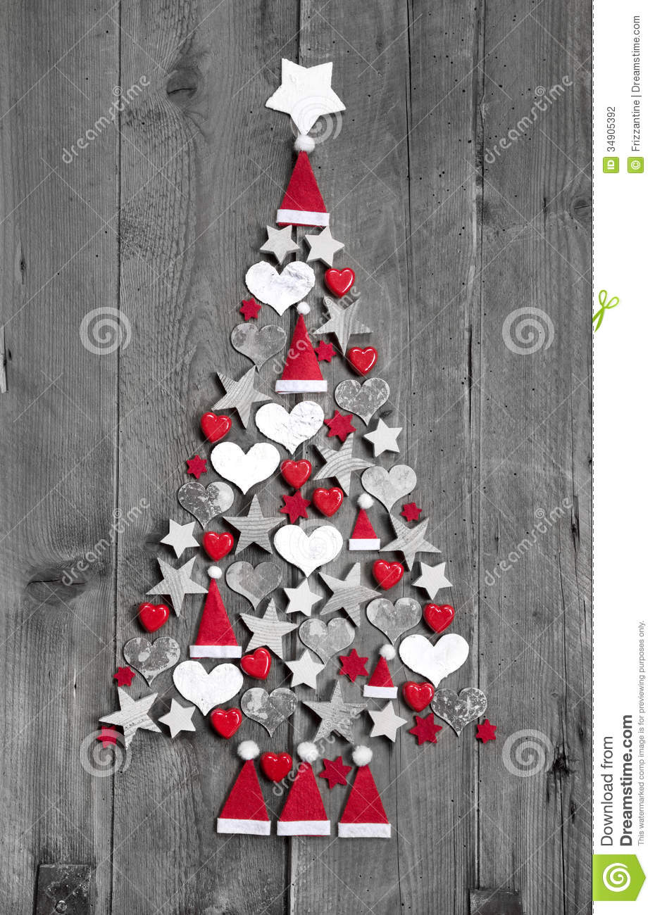 Christmas tree made up of decoration on grey wooden background - idea ...