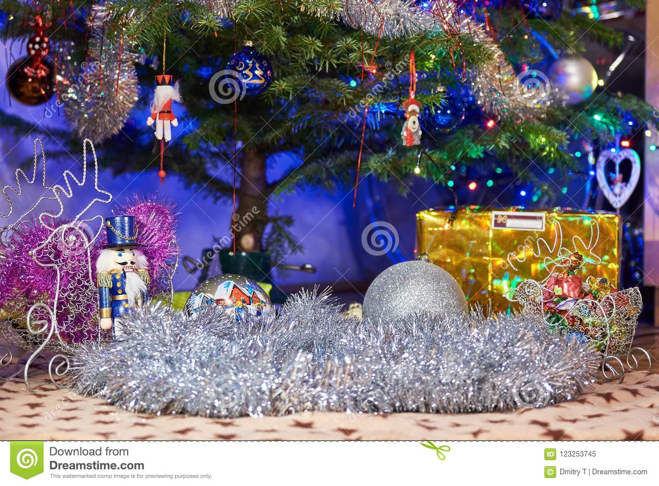 download christmas tree with many gifts on a christmas tree blurred background with bokeh from - How Many Gifts For Christmas