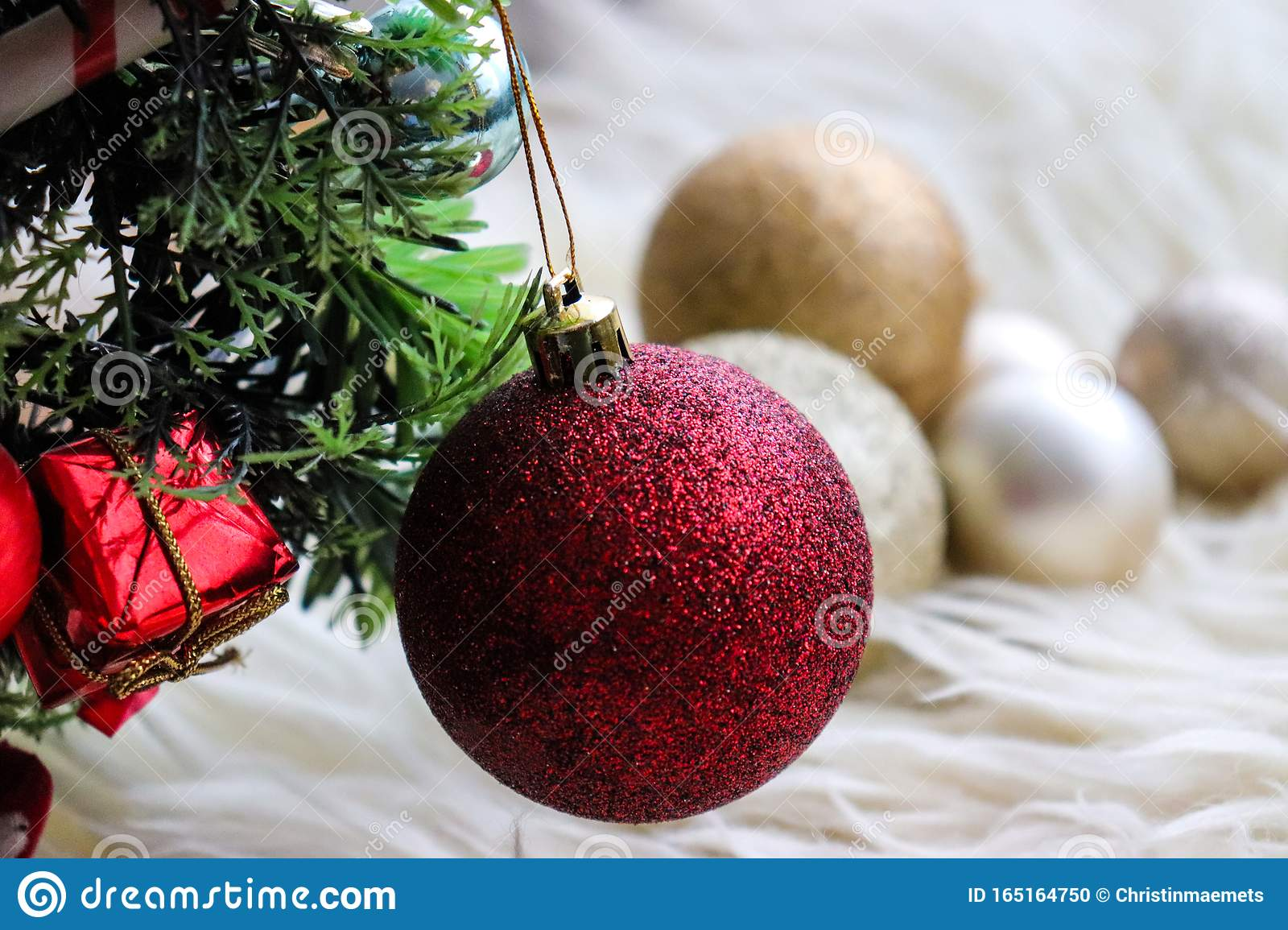 Red Gold And Silver Christmas Tree Decorations On A White Fur Carpet Glitter And Sparkle During The Holidays Stock Photo Image Of Vibes Gifts 165164750