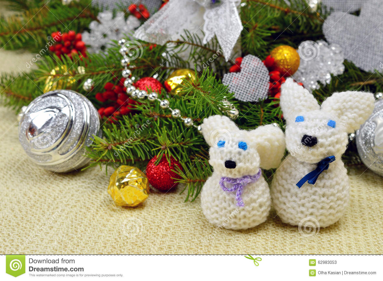 christmas tree with ornaments and knitted hare funny in a rusti - Funny Christmas Tree Ornaments