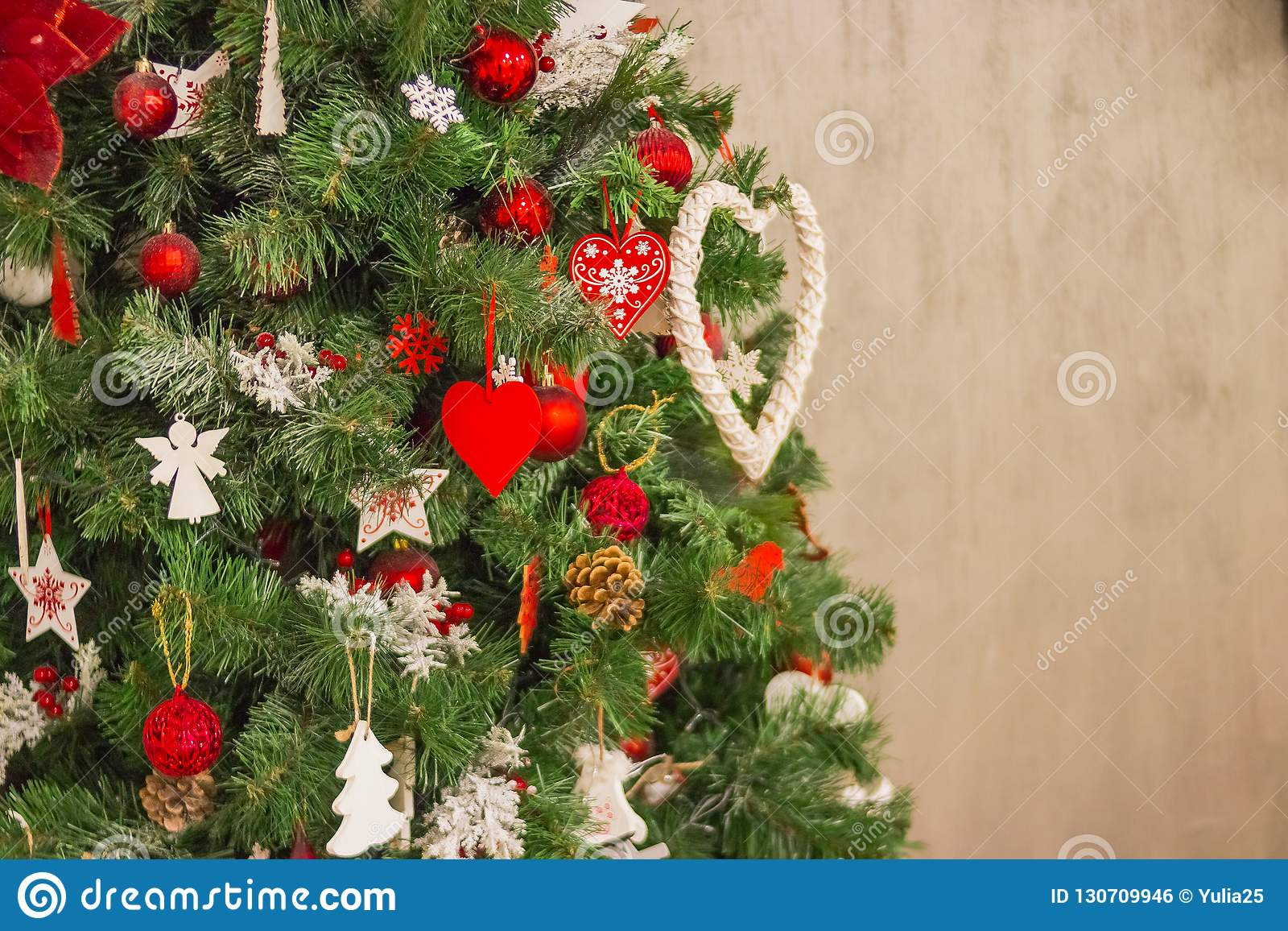 Hanging Christmas Decorations Wall.Christmas Tree Over Beige Wall Colorful Christmas