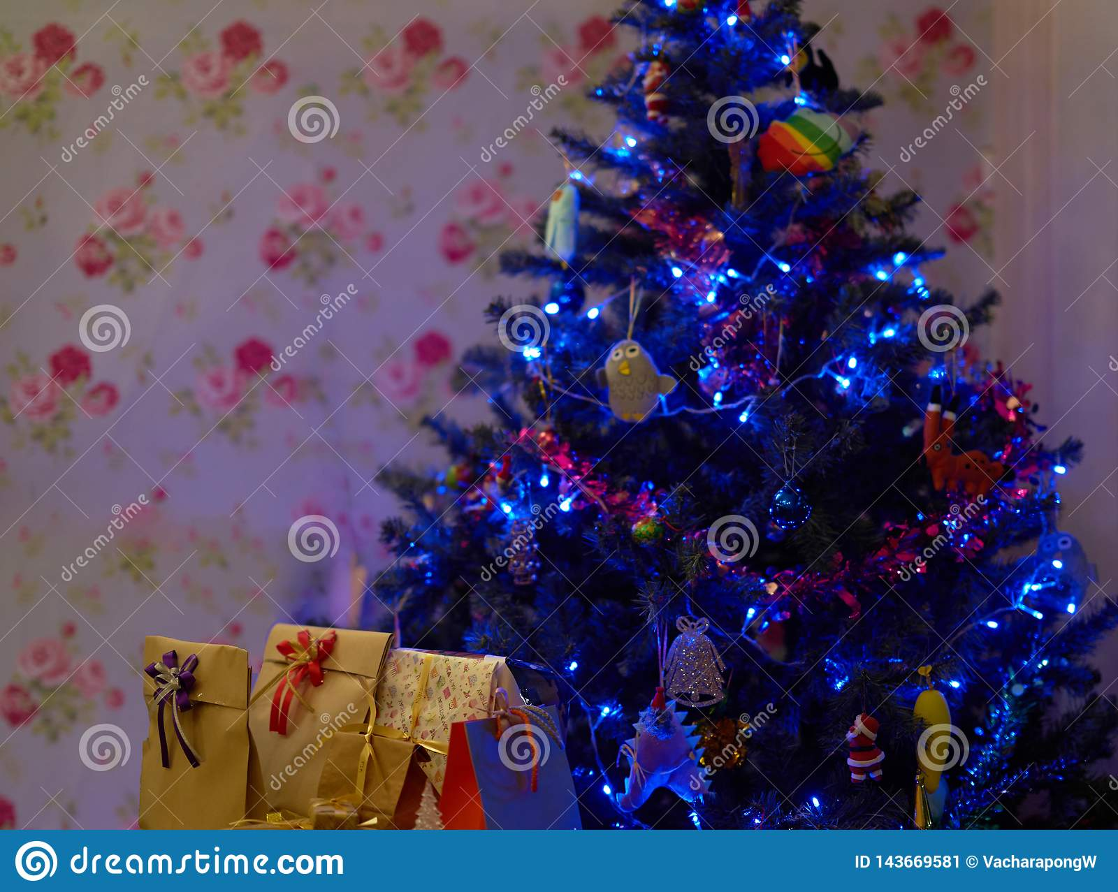 Christmas tree with present boxes inside house