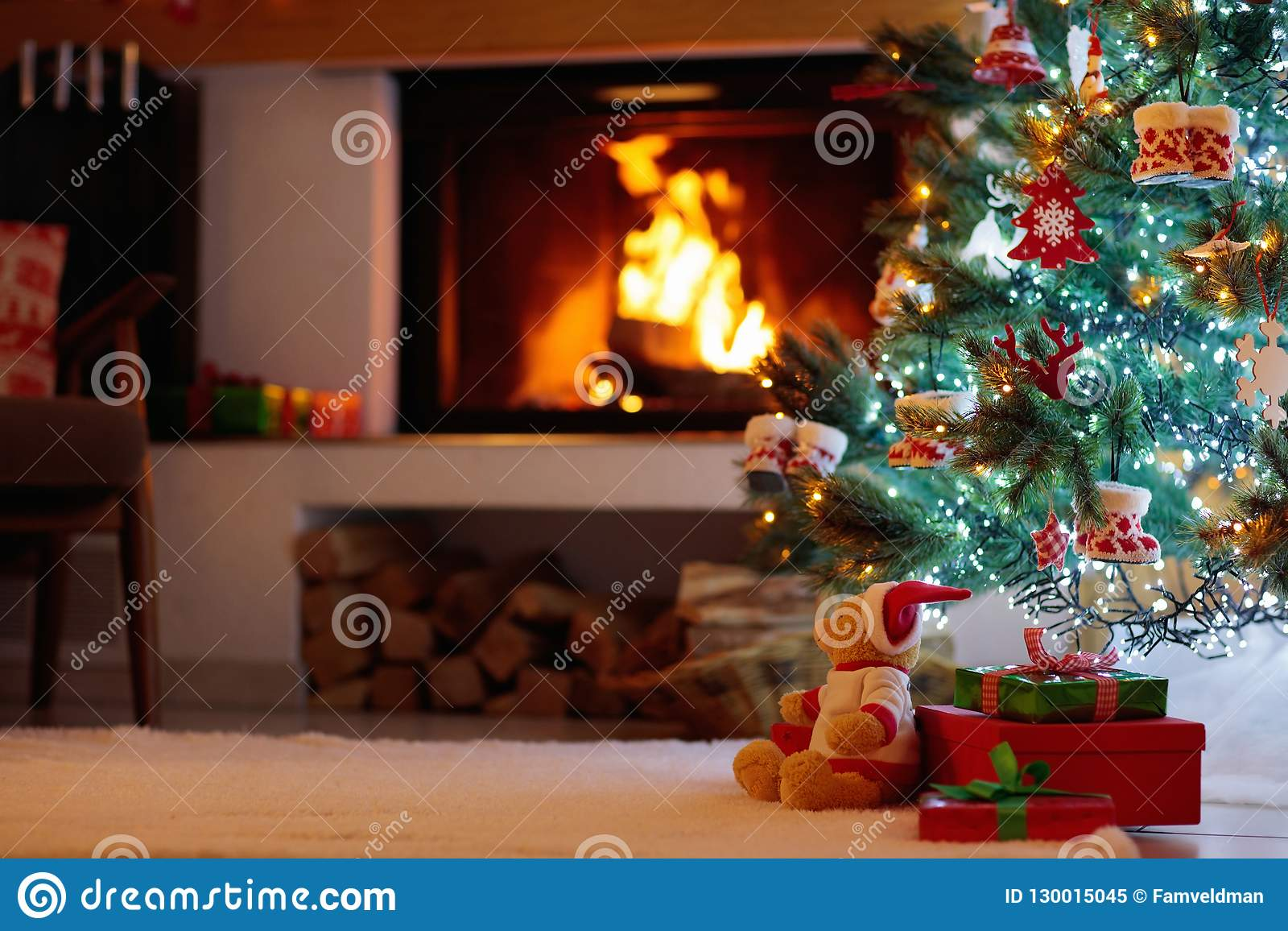 Christmas Tree With Presents At Fire Place Stock Image