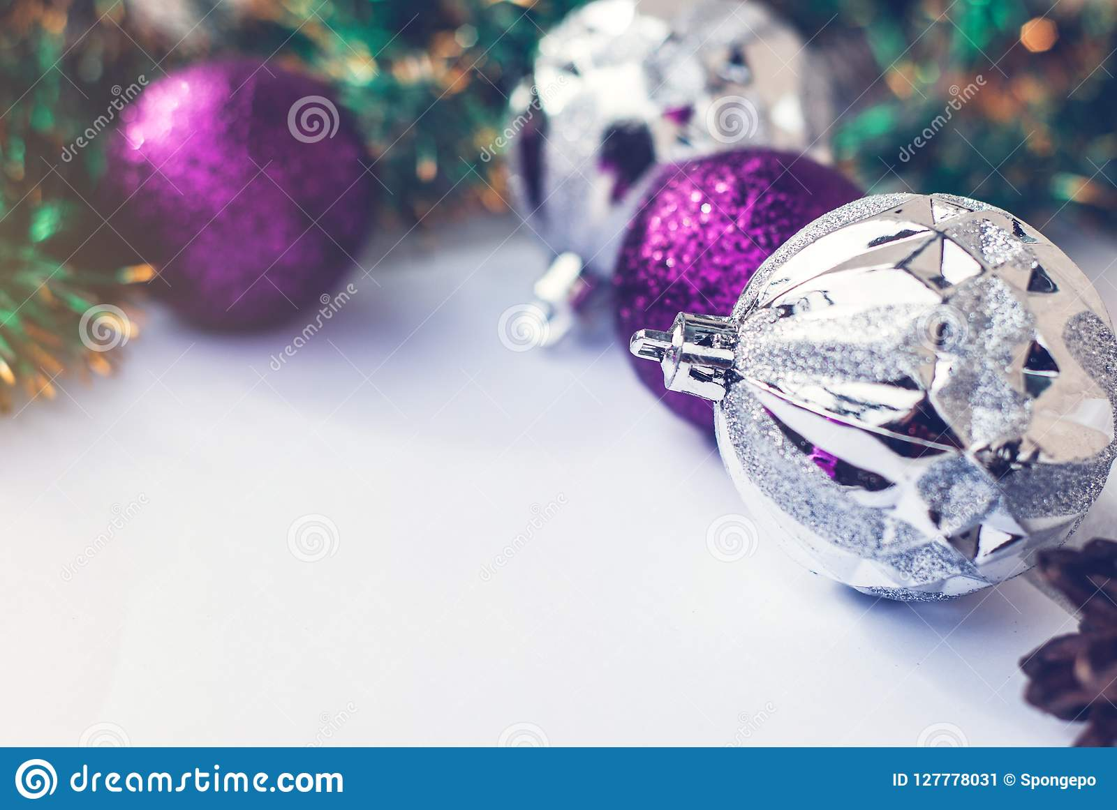 christmas tree purple and silver decorations balls on white retro wood background