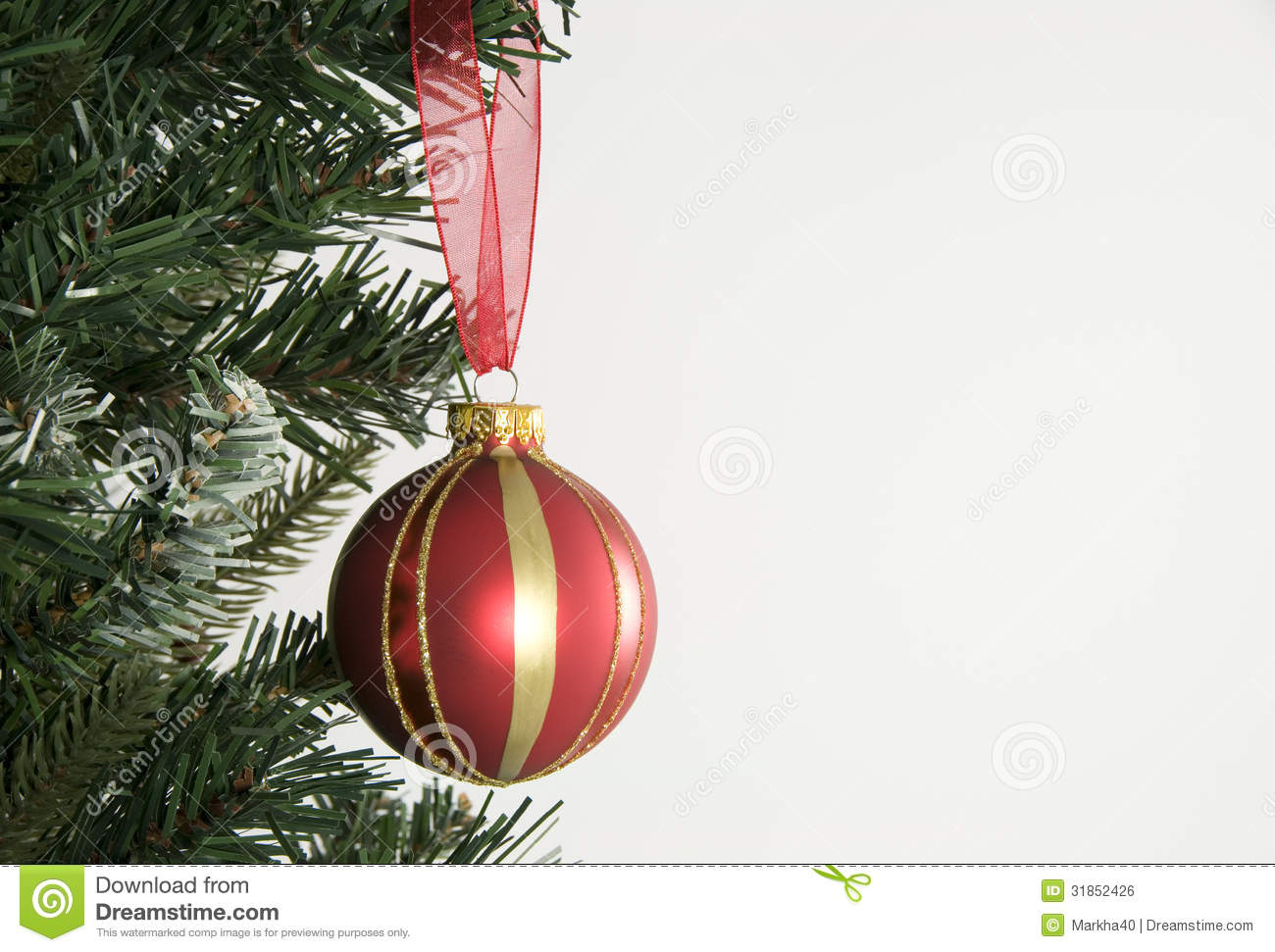 Christmas Tree And Red Hanging Decoration Stock Photo