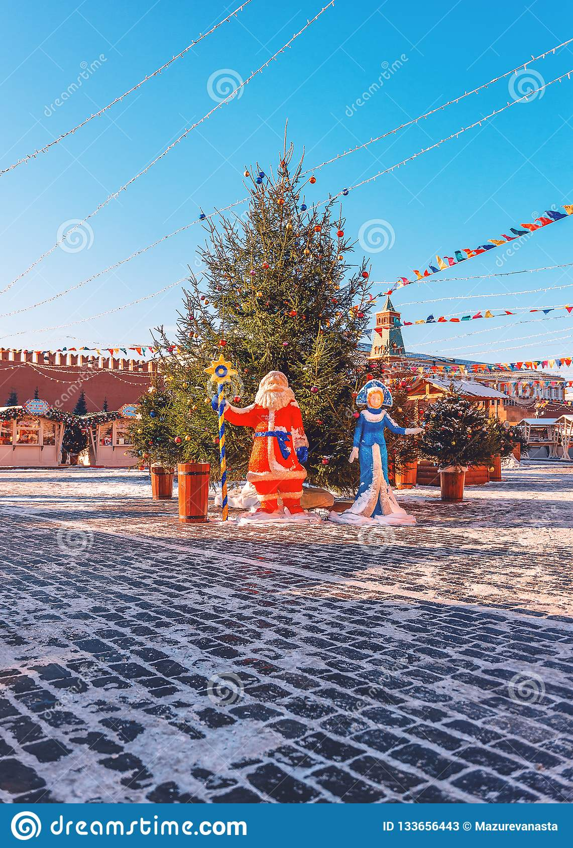 Christmas tree on the Red Square. New Year`s scenery. Ded Moroz and Snegurochka. New Year`s Fair.