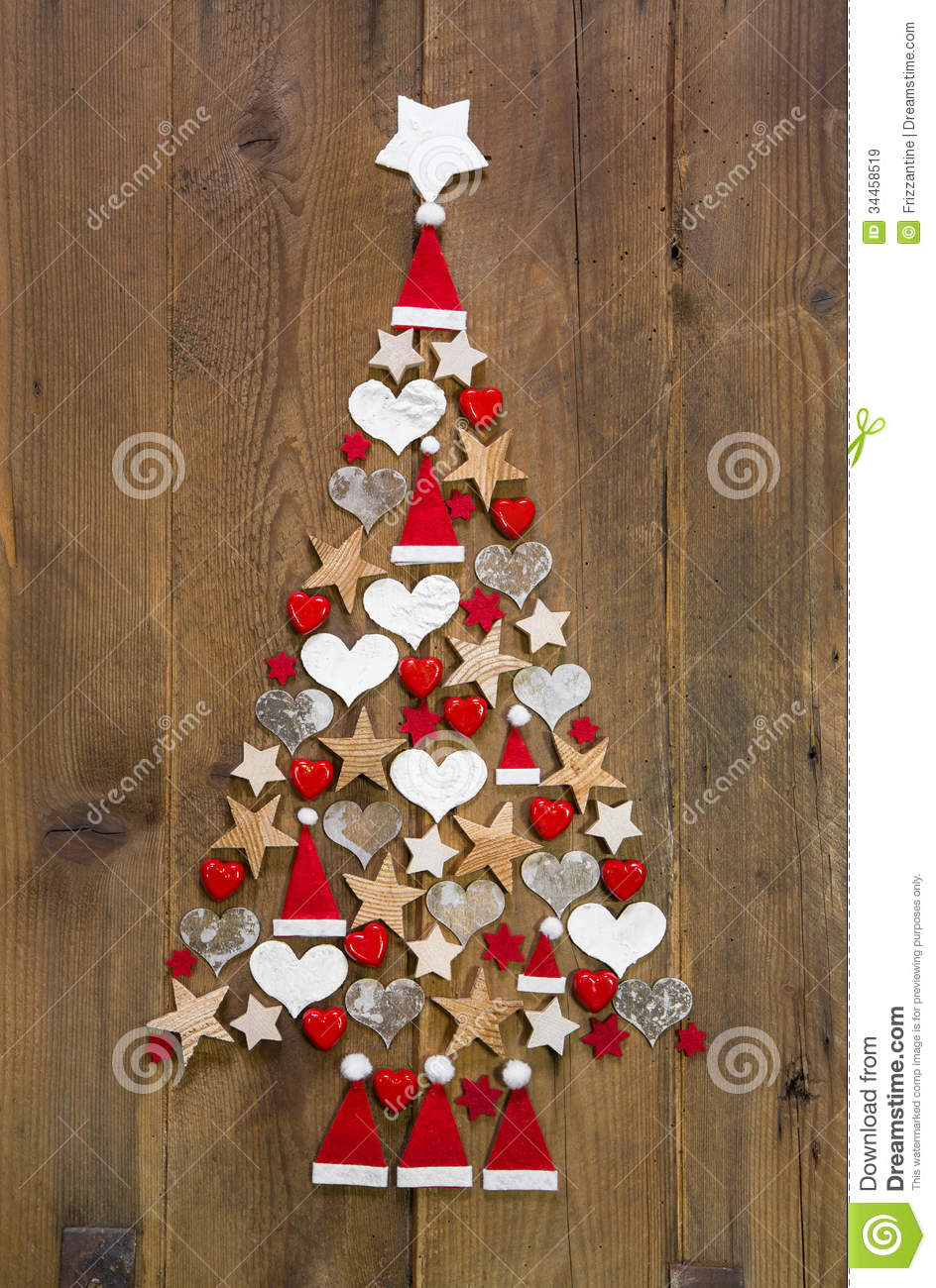 Christmas tree in red and white colour on a wooden background