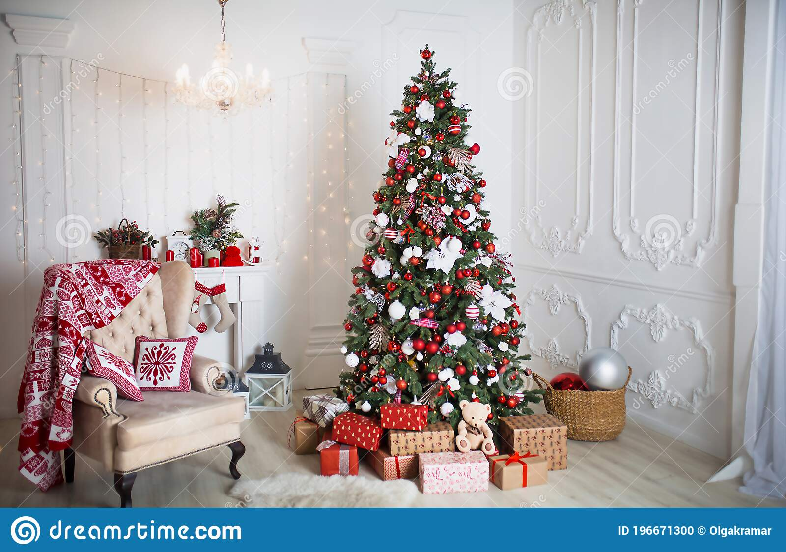 Christmas Tree With Red And White Decor In A White Living Room With Gifts In Boxes A Chair With Pillows And A Blanket With Winter Stock Photo Image Of Christmas House