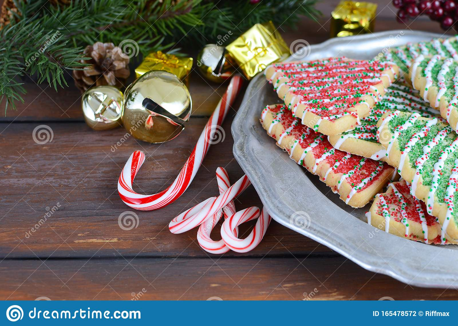Christmas Tree Shaped Sugar Cookies Candy Canes Pine Branches With Cones Mini Gifts And Jingle Bells Stock Photo Image Of Bells Cane 165478572