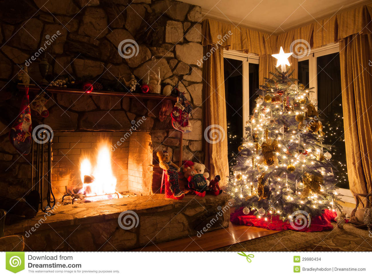Christmas Tree And Rustic Fireplace In A Cozy Home Stock