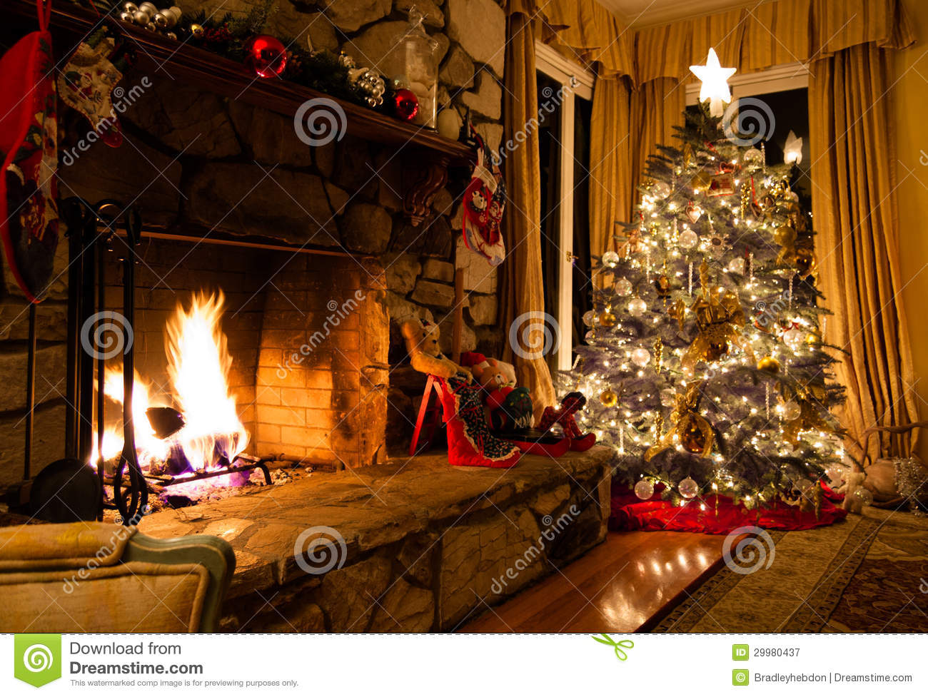 Christmas Tree And Rustic Fireplace In A Cozy Home Stock ...