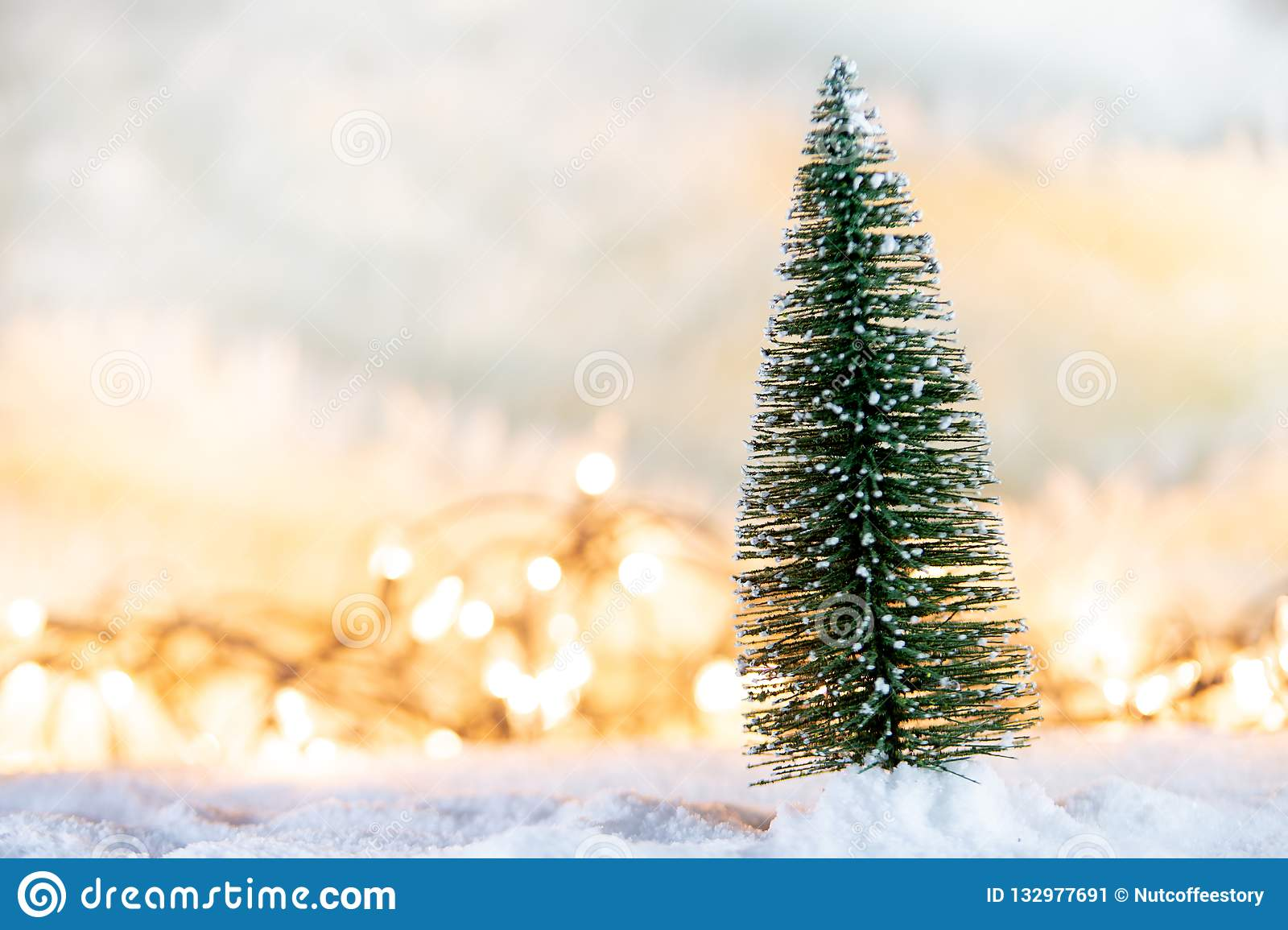 christmas tree snow gift light bokeh backgrounds snowy christmas new year festive background christmas tree snow gift 132977691