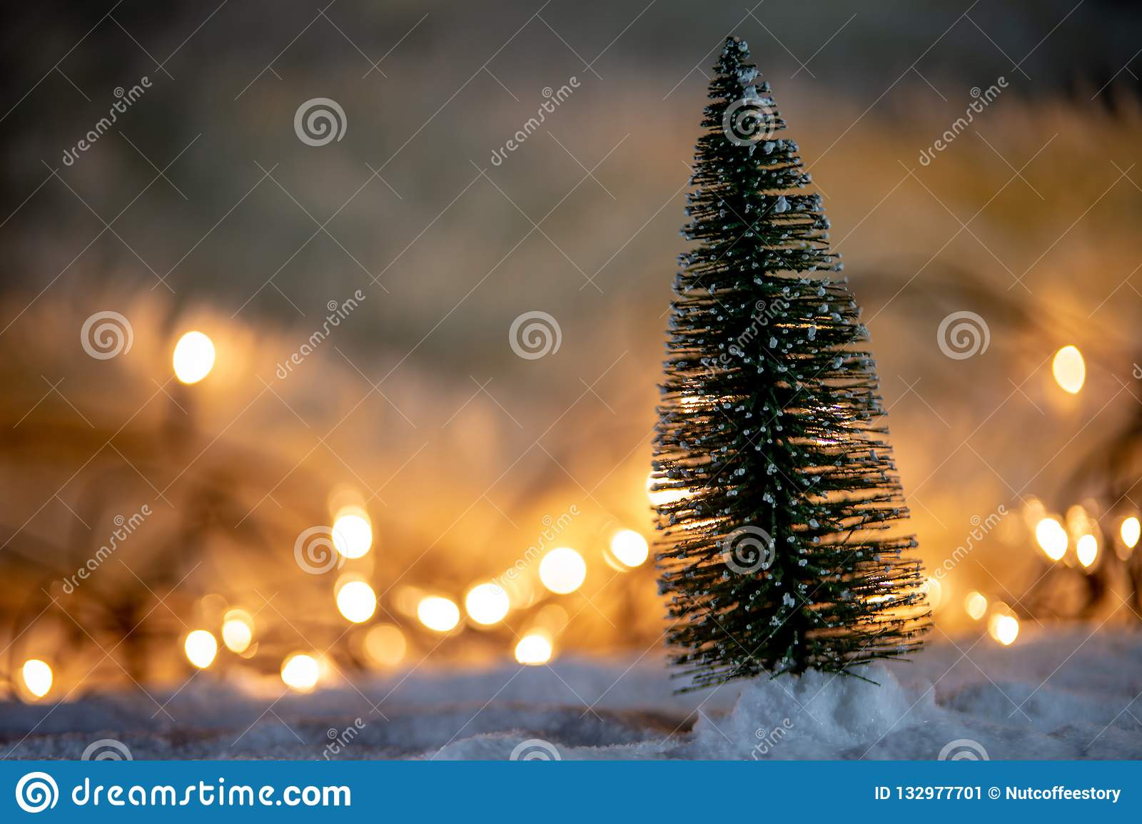 christmas tree snow gift light bokeh backgrounds snowy new year festive background 132977701