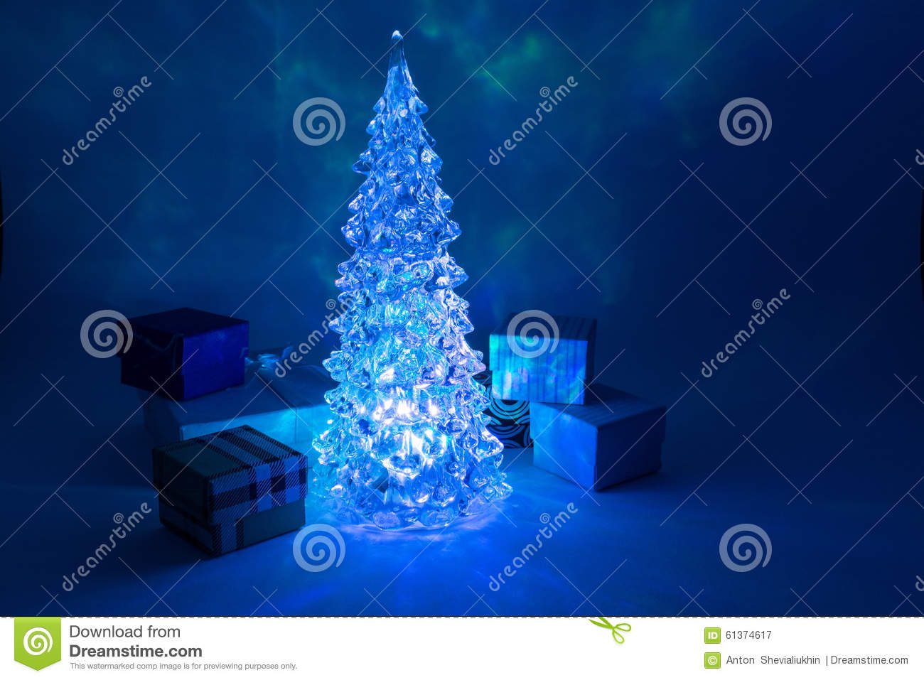 download christmas tree toy shining with a beautiful shadow with a gift around northern lights stock