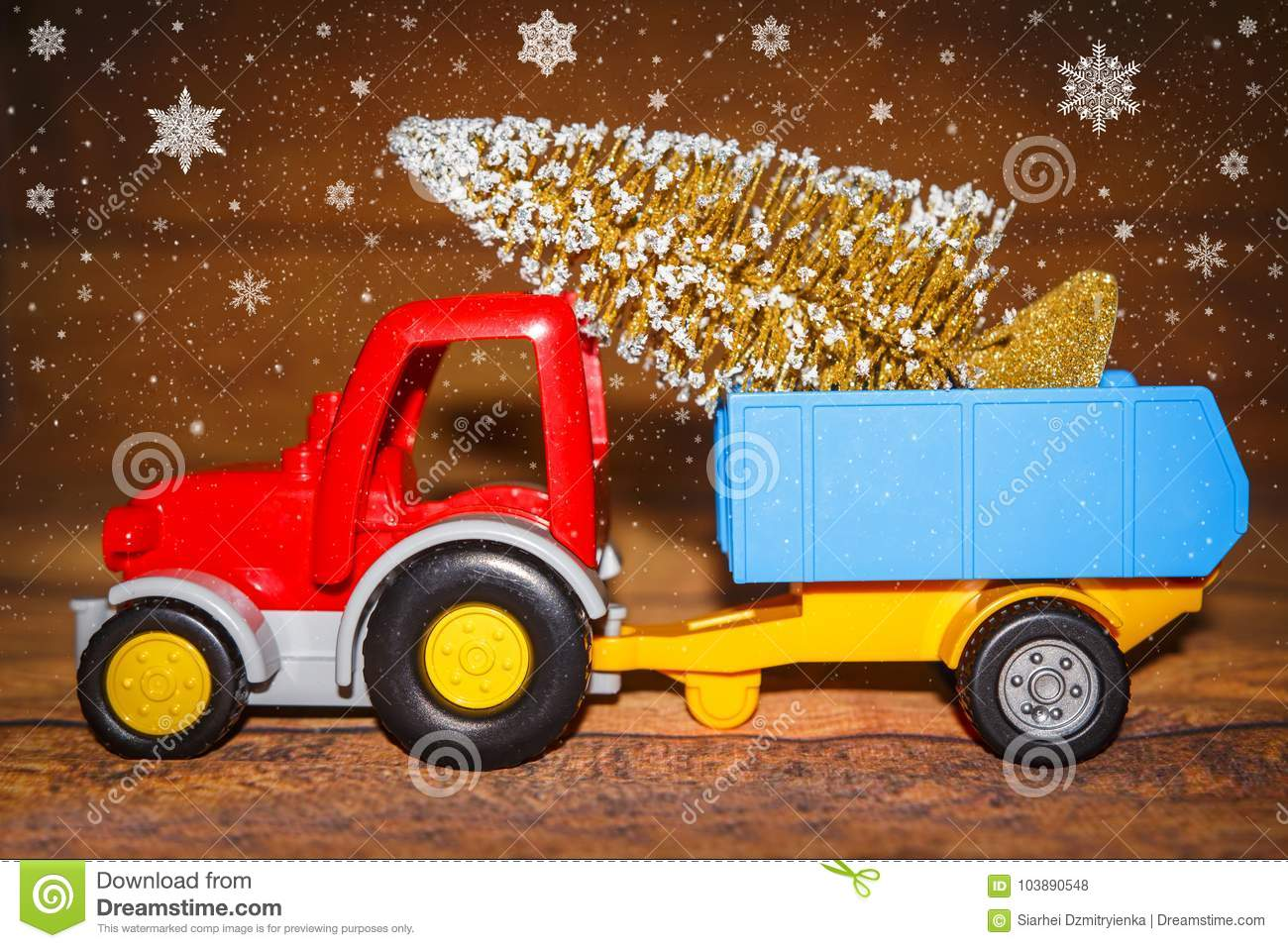 Christmas Tree On Toy Tractor With Trailer. Christmas Holiday ...
