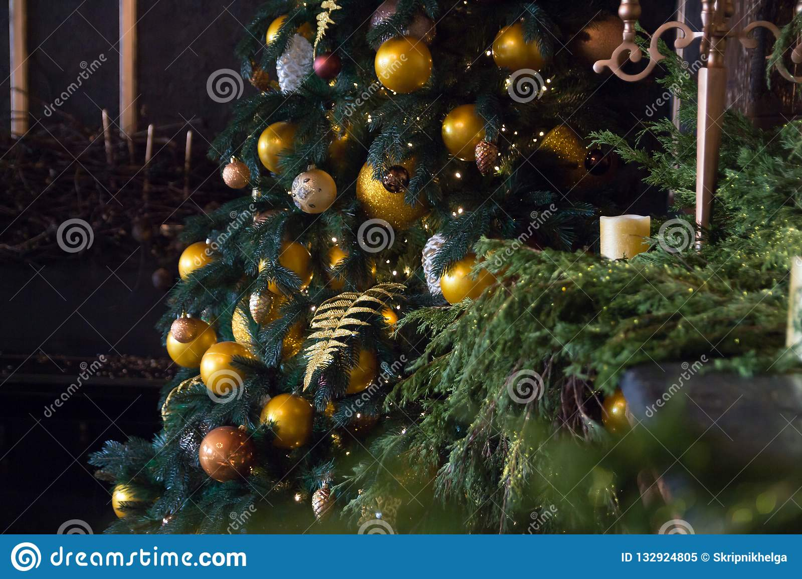 Christmas Tree With Yellow Balls Candles And Decorated Fireplace