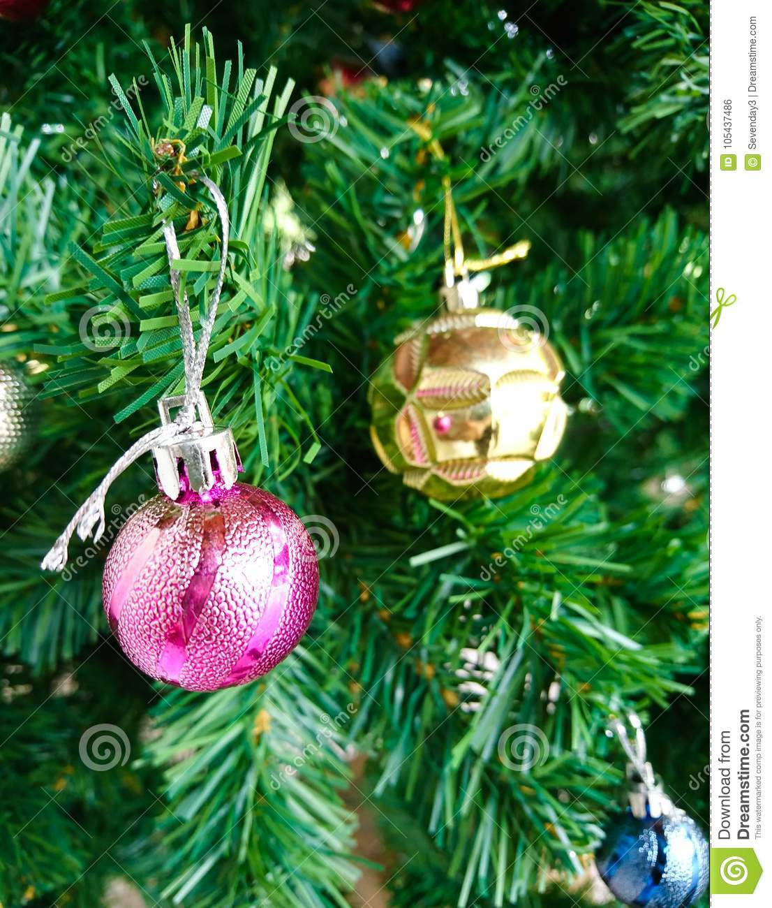 christmas trees and other decorations with color balls and green leaves on the xmas day