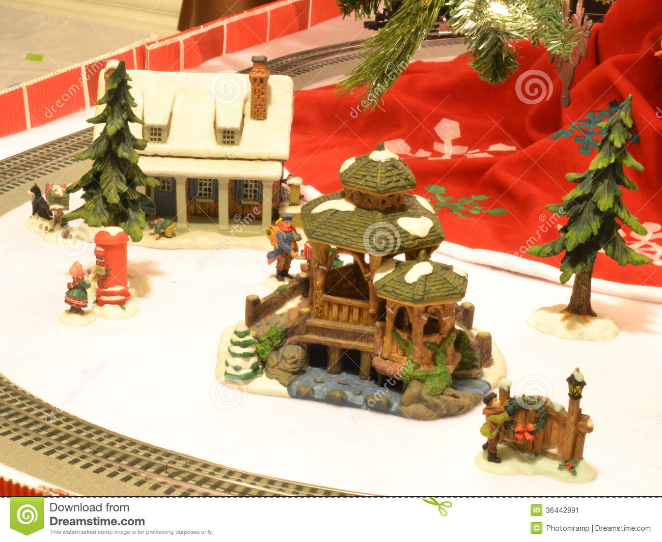 christmas decorations under tree with train in the background - Christmas Village Decorations