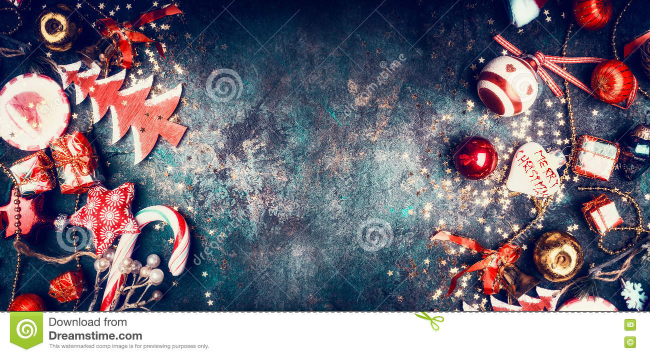 Christmas vintage background with sweets and red holiday decorations: Santa hat, tree, star, balls, top view