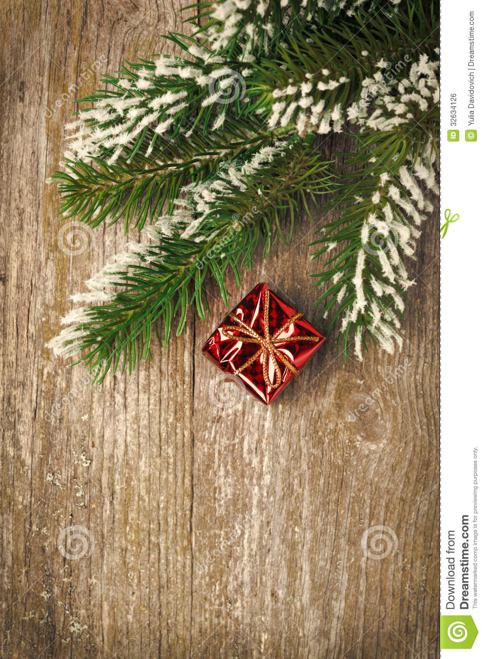 Download Christmas Vintage Wooden Background Spruce Branches And Gift Stock Photo