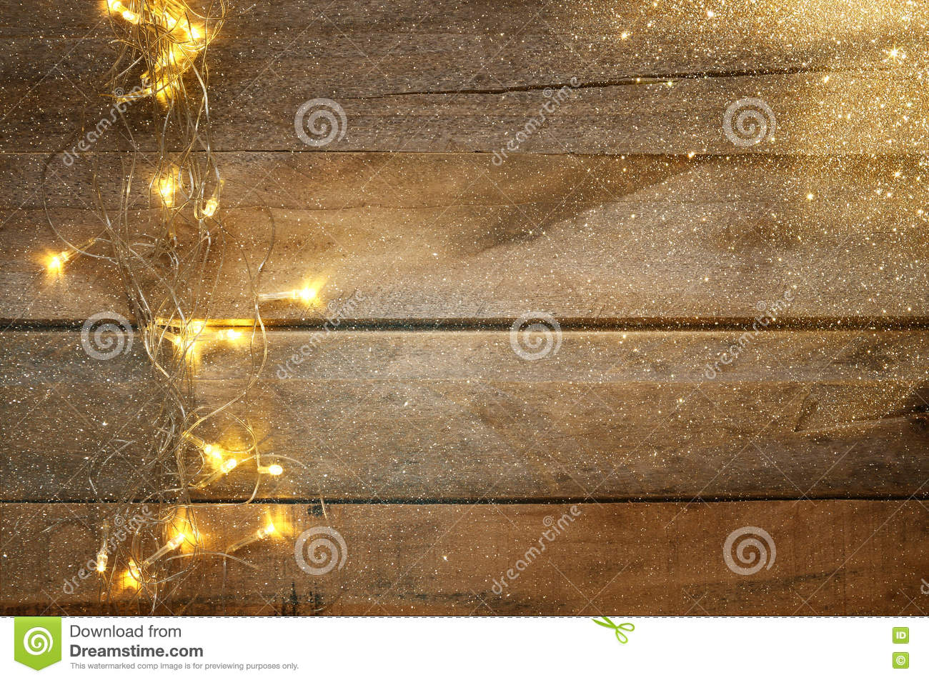 Christmas warm gold garland lights on wooden rustic background