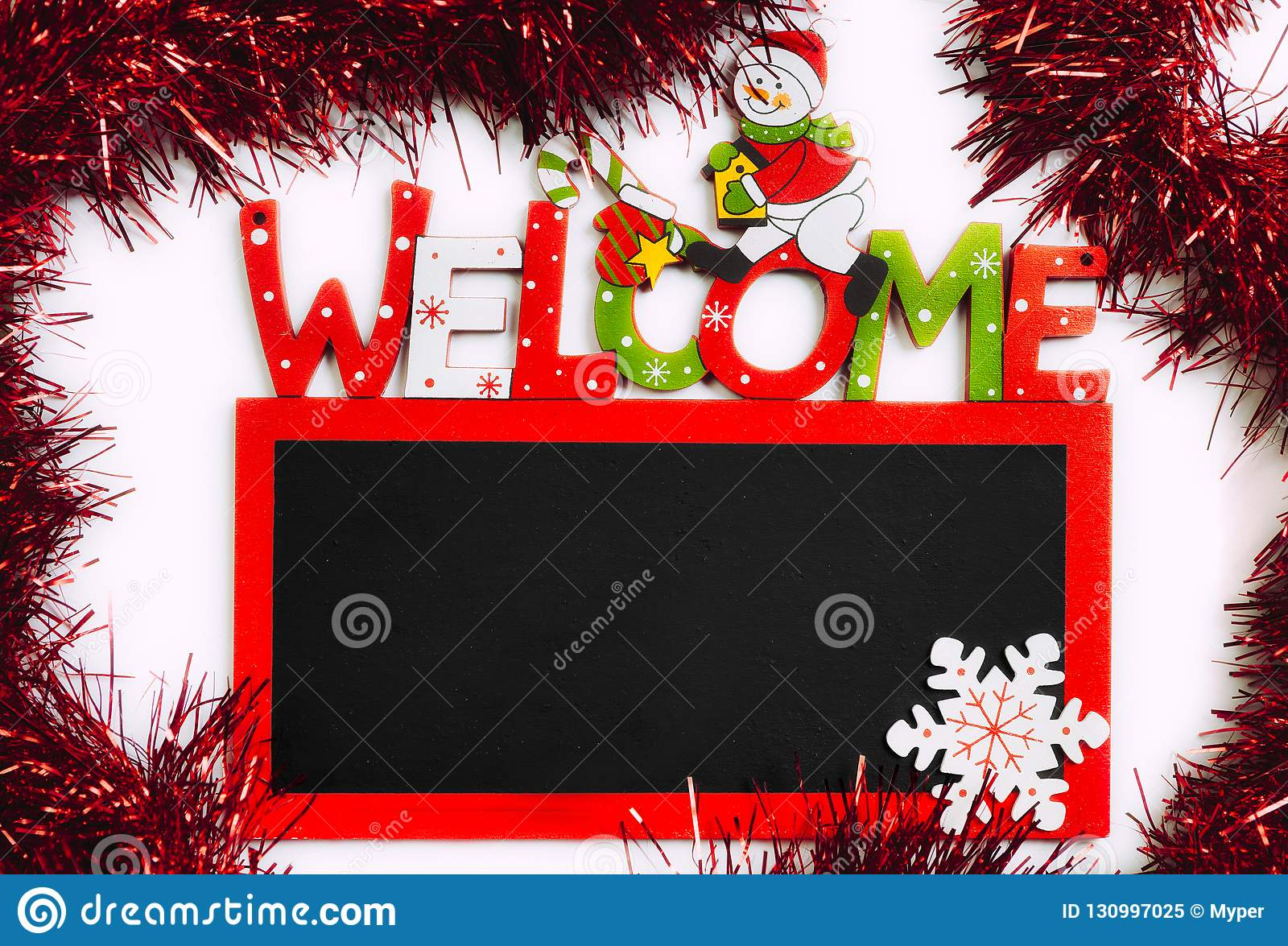 Welcome Christmas.Christmas Welcome Black Board With Red Ribbon Stock Image