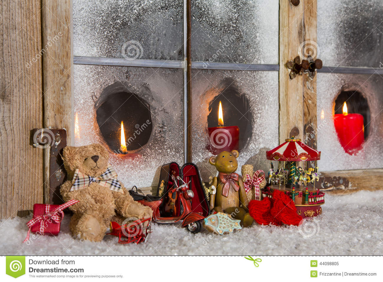 christmas window decoration candles with old children toys stock photo