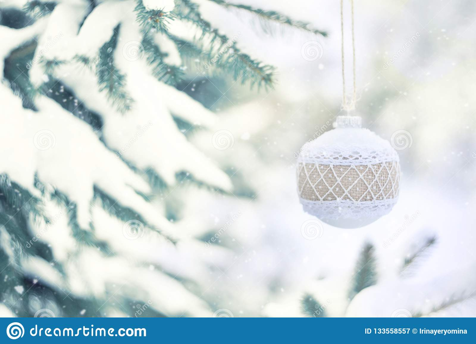 Christmas Winter Holiday Greeting Card White Rustic Christmas Ornament Ball With Burlap On Green Christmas Trees With Snow Stock Image Image Of Decoration Greeting 133558557