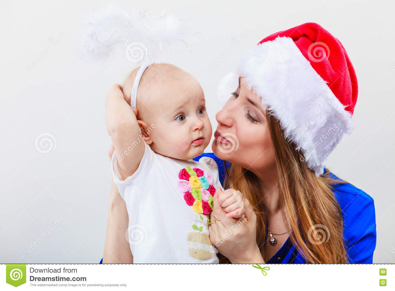38db5267bfe50 Christmas Woman With Cute Baby. Stock Image - Image of cute