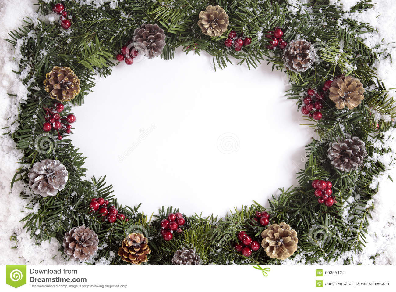 Christmas Wreath Border In Snow With White Copy Space Stock Photo ...