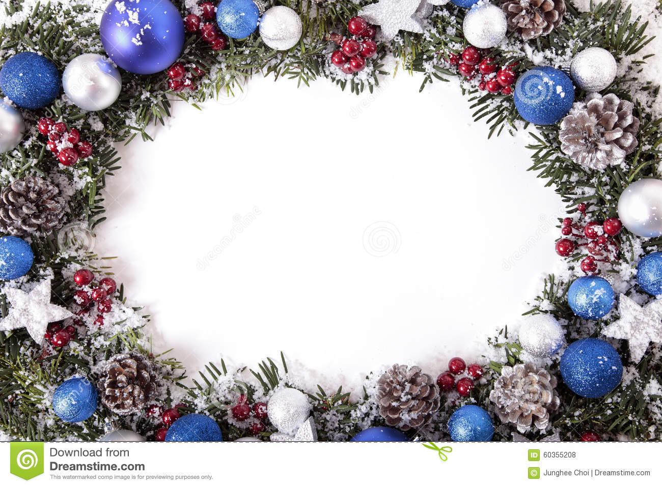 christmas wreath border in snow with white copy space